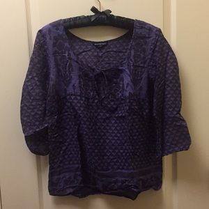 See through brown and purple blouse